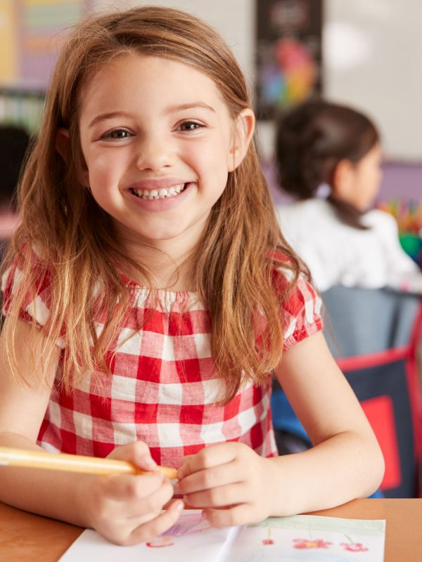portrait-of-smiling-female-elementary-school-WVG96AX-min