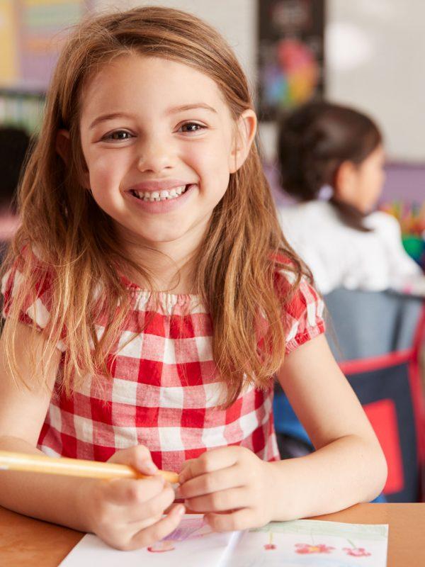 portrait-of-smiling-female-elementary-school-WVG96AX-min